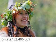 Portrait of smiling young woman in clothing aborigine of Kamchatka Peninsula. Редакционное фото, фотограф А. А. Пирагис / Фотобанк Лори