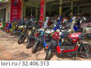 Купить «Магазин по продаже электрических скутеров в современном городе. Хюэ, Вьетнам», фото № 32406313, снято 8 января 2016 г. (c) Виктор Карасев / Фотобанк Лори