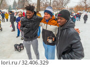 Купить «Russia, Samara, March 2019: Shrovetide. Africans on the wires of winter.», фото № 32406329, снято 10 марта 2019 г. (c) Акиньшин Владимир / Фотобанк Лори