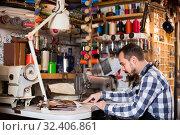 Купить «male worker sewing stitches on belt in leather workshop», фото № 32406861, снято 12 июля 2020 г. (c) Яков Филимонов / Фотобанк Лори