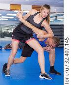 Купить «Active girl with professional trainer are training captures», фото № 32407145, снято 21 августа 2017 г. (c) Яков Филимонов / Фотобанк Лори