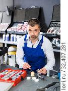 Купить «Mechanic selecting color for automobile upholstery», фото № 32407281, снято 4 апреля 2018 г. (c) Яков Филимонов / Фотобанк Лори