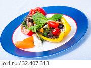 Купить «Stuffed peppers with mushrooms, rice, sesame, greens and vegetables», фото № 32407313, снято 15 декабря 2019 г. (c) Яков Филимонов / Фотобанк Лори