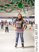 Купить «Portrait of cheerful woman dressed sweater, jeans and scarf standing on ice in hockey skates, indoor ice-scating rink with people», фото № 32407889, снято 13 января 2013 г. (c) Кекяляйнен Андрей / Фотобанк Лори