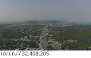Купить «City life, Cars and bikes traffic on asphalt road in Vietnam 4K Drone shot», видеоролик № 32408205, снято 3 ноября 2019 г. (c) Aleksejs Bergmanis / Фотобанк Лори