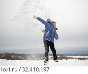 Купить «Happy child jumping. Lots of flying snow. Enjoy outdoor games in winter», фото № 32410197, снято 14 ноября 2019 г. (c) Ирина Козорог / Фотобанк Лори