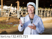 Купить «Adult woman is holding glass of milk», фото № 32415721, снято 24 октября 2017 г. (c) Яков Филимонов / Фотобанк Лори