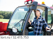 Купить «Positive woman farmer in the car at the cow farm», фото № 32415753, снято 24 октября 2017 г. (c) Яков Филимонов / Фотобанк Лори