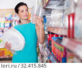 Купить «Female buying to disposable tableware at supermarket», фото № 32415845, снято 6 июня 2017 г. (c) Яков Филимонов / Фотобанк Лори