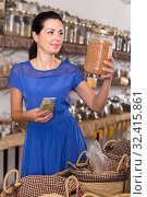Купить «adult woman choosing in glass cans natural dried herbs in organic shop», фото № 32415861, снято 13 июня 2017 г. (c) Яков Филимонов / Фотобанк Лори