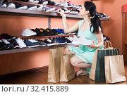 Купить «girl is demonstrating sport shoes that she choice for jogging.», фото № 32415889, снято 10 мая 2017 г. (c) Яков Филимонов / Фотобанк Лори
