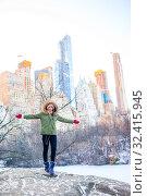 Купить «Adorable girl with view of ice-rink in Central Park on Manhattan in New York City», фото № 32415945, снято 1 января 2018 г. (c) Дмитрий Травников / Фотобанк Лори