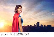 Купить «happy woman in superhero cape over tallinn city», фото № 32420497, снято 30 сентября 2019 г. (c) Syda Productions / Фотобанк Лори