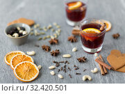 Купить «hot mulled wine, orange slices, raisins and spices», фото № 32420501, снято 4 октября 2018 г. (c) Syda Productions / Фотобанк Лори