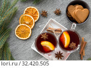 Купить «mulled wine, orange slices, gingerbread and spices», фото № 32420505, снято 4 октября 2018 г. (c) Syda Productions / Фотобанк Лори