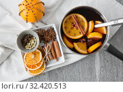 Купить «pot with hot mulled wine, orange slices and spices», фото № 32420513, снято 4 октября 2018 г. (c) Syda Productions / Фотобанк Лори