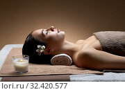 Купить «young woman lying at spa or massage parlor», фото № 32420577, снято 13 октября 2019 г. (c) Syda Productions / Фотобанк Лори