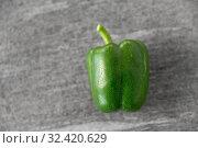 Купить «close up of green pepper on slate stone background», фото № 32420629, снято 12 апреля 2018 г. (c) Syda Productions / Фотобанк Лори