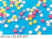 Купить «star shaped pastry sprinkles on blue background», фото № 32420657, снято 11 декабря 2018 г. (c) Syda Productions / Фотобанк Лори