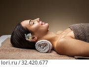Купить «young woman lying at spa or massage parlor», фото № 32420677, снято 13 октября 2019 г. (c) Syda Productions / Фотобанк Лори