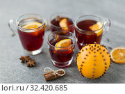 Купить «glasses of mulled wine with orange and cinnamon», фото № 32420685, снято 4 октября 2018 г. (c) Syda Productions / Фотобанк Лори