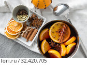 Купить «pot with hot mulled wine, orange slices and spices», фото № 32420705, снято 4 октября 2018 г. (c) Syda Productions / Фотобанк Лори