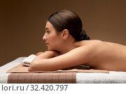 Купить «young woman lying at spa or massage parlor», фото № 32420797, снято 13 октября 2019 г. (c) Syda Productions / Фотобанк Лори