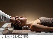 Купить «woman having face and head massage at spa», фото № 32420805, снято 13 октября 2019 г. (c) Syda Productions / Фотобанк Лори