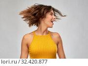 Купить «happy young woman shaking head», фото № 32420877, снято 30 сентября 2019 г. (c) Syda Productions / Фотобанк Лори