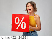 Купить «happy smiling young woman with sale signs», фото № 32420881, снято 30 сентября 2019 г. (c) Syda Productions / Фотобанк Лори