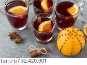 Купить «glasses of mulled wine with orange and cinnamon», фото № 32420901, снято 4 октября 2018 г. (c) Syda Productions / Фотобанк Лори