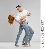 portrait of happy couple in white t-shirts dancing. Стоковое фото, фотограф Syda Productions / Фотобанк Лори