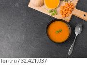 Купить «vegetable pumpkin cream soup in bowl with spoon», фото № 32421037, снято 5 апреля 2018 г. (c) Syda Productions / Фотобанк Лори