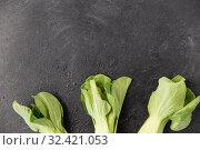 Купить «close up of bok choy cabbage on slate background», фото № 32421053, снято 12 апреля 2018 г. (c) Syda Productions / Фотобанк Лори