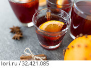 Купить «glasses of mulled wine with orange and cinnamon», фото № 32421085, снято 4 октября 2018 г. (c) Syda Productions / Фотобанк Лори