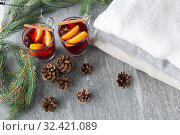 Купить «mulled wine with orange and spices, cones and fir», фото № 32421089, снято 4 октября 2018 г. (c) Syda Productions / Фотобанк Лори