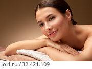 Купить «young woman lying at spa or massage parlor», фото № 32421109, снято 13 октября 2019 г. (c) Syda Productions / Фотобанк Лори