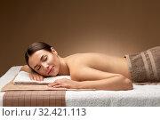 Купить «young woman lying at spa or massage parlor», фото № 32421113, снято 13 октября 2019 г. (c) Syda Productions / Фотобанк Лори