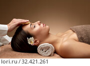close up of woman having face massage in spa. Стоковое фото, фотограф Syda Productions / Фотобанк Лори