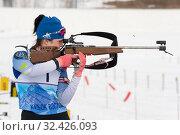 Купить «Sportswoman biathlete Elena Hairulina (Yugorsk) rifle shooting standing position», фото № 32426093, снято 12 апреля 2019 г. (c) А. А. Пирагис / Фотобанк Лори