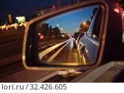 Купить «Вид в зеркало заднего вида», фото № 32426605, снято 18 июня 2019 г. (c) Victoria Demidova / Фотобанк Лори