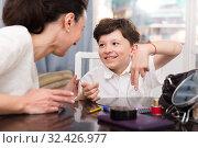 Купить «Smiling boy talking with woman», фото № 32426977, снято 28 марта 2019 г. (c) Яков Филимонов / Фотобанк Лори