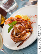 Купить «Delicious cooked squid or octopus tentacles with lemon and parsley on a plate», фото № 32427337, снято 22 февраля 2020 г. (c) Яков Филимонов / Фотобанк Лори