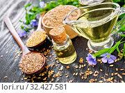 Масло льняное с мукой и семенами на черной доске. Стоковое фото, фотограф Резеда Костылева / Фотобанк Лори