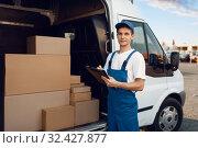 Купить «Deliveryman in uniform, carton boxes in the car», фото № 32427877, снято 8 сентября 2019 г. (c) Tryapitsyn Sergiy / Фотобанк Лори