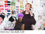 Купить «Woman with needlework accessories and talking on phone», фото № 32428729, снято 10 мая 2017 г. (c) Яков Филимонов / Фотобанк Лори