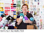 Купить «Woman holding shopping bags and accessories for knitting and embroidery», фото № 32428733, снято 10 мая 2017 г. (c) Яков Филимонов / Фотобанк Лори