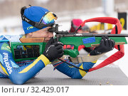 Купить «Kazakhstan sportswoman biathlete Kryukova Arina rifle shooting in prone position. Biathlete in shooting range», фото № 32429017, снято 12 апреля 2019 г. (c) А. А. Пирагис / Фотобанк Лори