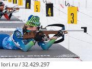 Купить «Sportswoman biathlete Anastasia Legostaeva rifle shooting in prone position. Biathlete in shooting range», фото № 32429297, снято 12 апреля 2019 г. (c) А. А. Пирагис / Фотобанк Лори