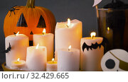 Купить «pumpkins, candles and halloween decorations», видеоролик № 32429665, снято 14 ноября 2019 г. (c) Syda Productions / Фотобанк Лори